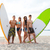 friends in sunglasses with surfboards on beach stock photo © dolgachov