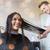 mujer · peluquero · tienda · pelo · largo · mirando - foto stock © dolgachov