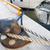 rusted iron mooring bollard with rope on pier stock photo © dolgachov