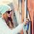 huligán · napszemüveg · grunge · épületek · férfi · boldog - stock fotó © dolgachov