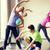 group of smiling people stretching in gym stock photo © dolgachov