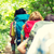 close up of friends with backpacks hiking stock photo © dolgachov