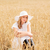 happy young woman in sun hat on cereal field stock photo © dolgachov