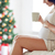 close up of pregnant woman with tea cup at home stock photo © dolgachov