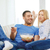 smiling couple with popcorn choosing what to watch stock photo © dolgachov