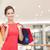 mosolyog · fiatal · nő · bevásárlótáskák · boldogság · fogyasztói · társadalom · vásár - stock fotó © dolgachov