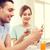 smiling couple with smartphones reading news stock photo © dolgachov