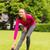smiling black woman stretching leg outdoors stock photo © dolgachov