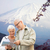 happy senior couple with travel map over mountains stock photo © dolgachov