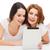 two smiling teenage girsl with tablet pc computer stock photo © dolgachov
