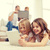 sonriendo · hermana · padres · atrás · familia - foto stock © dolgachov