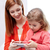 happy mother and daughter with smartphone at home stock photo © dolgachov