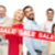 happy people with red sale sign showing thumbs up foto stock © dolgachov