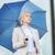 young serious businesswoman with umbrella outdoors stock photo © dolgachov