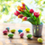 close up of easter eggs and flowers in tin bucket stock photo © dolgachov