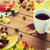 close up of tea cup on table with autumn leaves stock photo © dolgachov