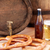 close up of beer barrel glass pretzel and bottle stock photo © dolgachov