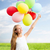 happy girl with colorful balloons stock photo © dolgachov