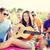 csoport · barátok · szórakozás · tengerpart · nyár · ünnepek - stock fotó © dolgachov