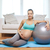 happy pregnant woman with fitball at home stock photo © dolgachov