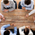 close up of business team sitting at table stock photo © dolgachov