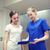 sorridente · enfermeira · menina · hospital · medicina - foto stock © dolgachov