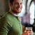 glücklich · junger · Mann · trinken · Bier · bar · Veröffentlichung - stock foto © dolgachov