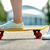 close up of female feet riding short skateboard stock photo © dolgachov