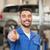 happy auto mechanic man or smith at car workshop stock photo © dolgachov
