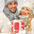 romantic couple in a sweaters with gift box stock photo © dolgachov