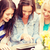 three beautiful girls looking at tablet pc in cafe stock photo © dolgachov