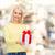 smiling girl with gift box stock photo © dolgachov