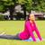 smiling woman stretching on mat outdoors stock photo © dolgachov