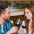 happy couple dining and drink wine at restaurant stock photo © dolgachov