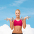 smiling woman lifting steel dumbbells stock photo © dolgachov