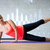 smiling woman doing exercises on mat in gym stock photo © dolgachov