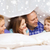 happy family with two kids under blanket at home stock photo © dolgachov