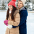 happy couple ice skating on rink outdoors stock photo © dolgachov
