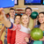 happy friends with smartphone in bowling club stock photo © dolgachov