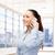 smiling businesswoman with smartphone stock photo © dolgachov