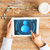 close up of hands with user icon on tablet pc stock photo © dolgachov