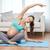 happy pregnant woman exercising at home stock photo © dolgachov
