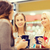 smiling young women with cups in mall or cafe stock photo © dolgachov