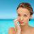 szczęśliwy · młoda · kobieta · krem · twarz · piękna - zdjęcia stock © dolgachov