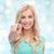 mosolyog · fiatal · szőke · nő · mutat · kép · visel - stock fotó © dolgachov