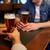 close up of men drinking beer at bar or pub stock photo © dolgachov