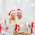 happy couple with christmas gifts and thumbs up stock photo © dolgachov