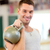 smiling man with kettlebell in gym stock photo © dolgachov