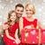 smiling family holding gift box stock photo © dolgachov