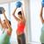 happy pregnant women exercising with ball in gym stock photo © dolgachov